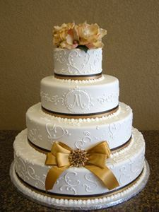 Picture of Gold Magnolia & Ribbon Wedding Cake