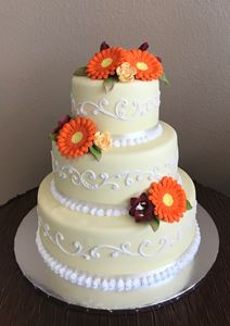 Picture of Yellow Spring Scrolled Wedding Cake