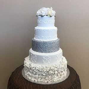 Picture of Sequins, Petals & Scrolled Wedding Cake